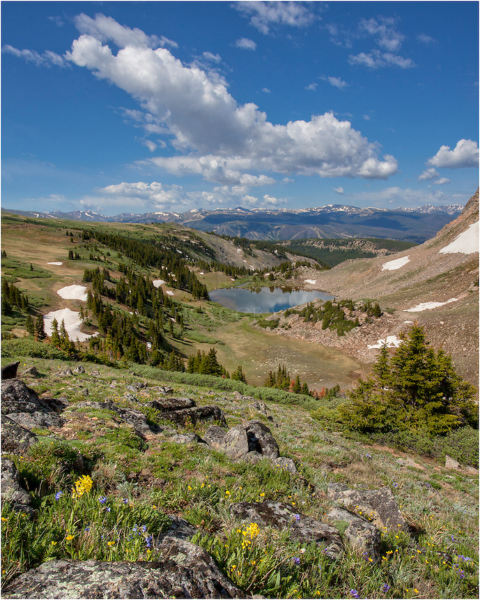 High above the town of Winter Park, this Colorado image of Deadman's Lake was taken in the summer on a peaceful morning. The road up and down isn't so peaceful - 15 miles of rock and dirt. I once shredded a tired 14 miles up. That made for a long, tenuous ride home, but the landscapes and vistas from up here almost make it worth it!