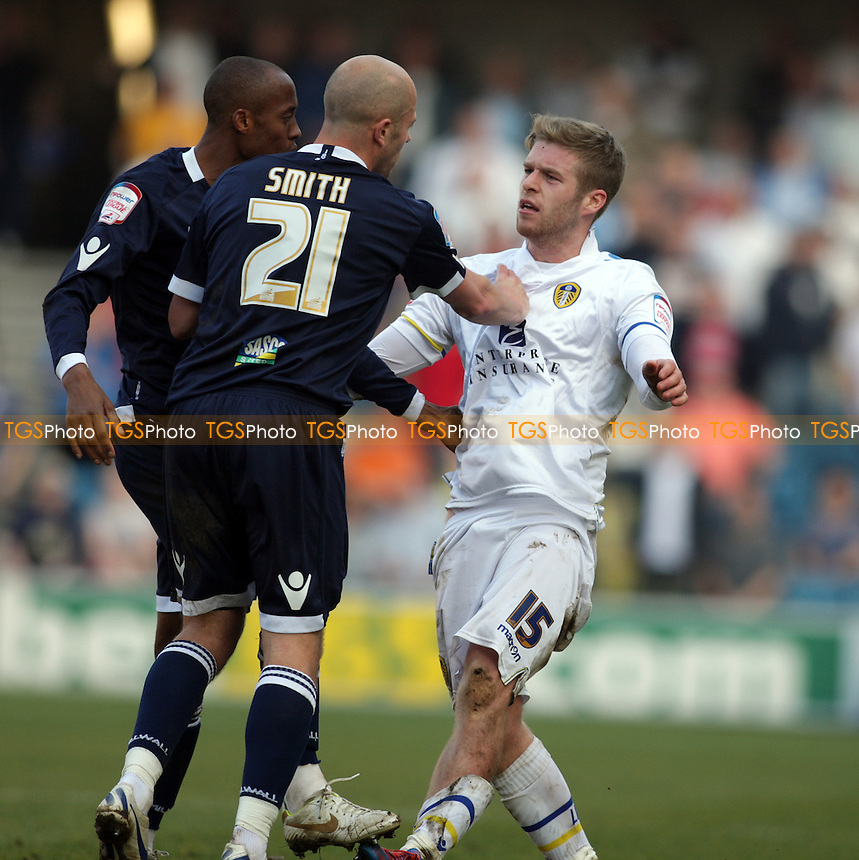 Jack Smith of Millwall FC pushes Adam Clayton of Leeds United after a tackle on the ground - Millwall vs Leeds United - nPower Championship Football at the New Den, London - 24/03/12 - MANDATORY CREDIT: Helen Watson/TGSPHOTO - Self billing applies where appropriate - 0845 094 6026 - contact@tgsphoto.co.uk - NO UNPAID USE.