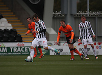 Graham Carey watched by Mark Millar and Jon Robertson in the St Mirren v Dundee United Clydesdale Bank Scottish Premier League match played at St Mirren Park, Paisley on 27.10.12.