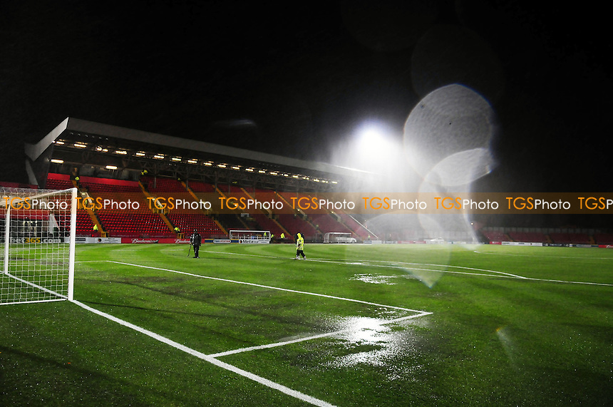 Puddles form on the pitch - Gateshead vs Oxford United - FA Cup 1st Round Replay at the Gateshead International Stadium - 20/11/13 - MANDATORY CREDIT: Steven White/TGSPHOTO - Self billing applies where appropriate - 0845 094 6026 - contact@tgsphoto.co.uk - NO UNPAID USE