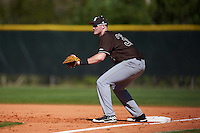 St. Bonaventure Bonnies first baseman T.J. Baker (32) holds a runner on during a game against the Dartmouth Big Green on February 25, 2017 at North Charlotte Regional Park in Port Charlotte, Florida.  St. Bonaventure defeated Dartmouth 8-7.  (Mike Janes/Four Seam Images)