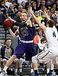 SIOUX FALLS, SD - FEBRUARY 27:  Drew Guebert #23 from the University of Sioux Falls looks for a teammate while being pressured by Adam Beyer #11 from Augustana during their NSIC Tournament game Saturday night at the Pentagon in Sioux Falls. (Photo by Dave Eggen/Inertia)