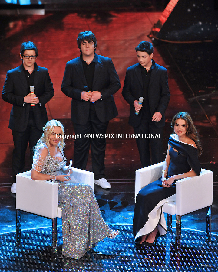 """QUEEN RANIA.with TV presenter Antonella Clerici and Opera's Trio on the 2nd Night of the 60th Festival of Italian Song, San Remo, Italy_17/02/2010.Mandatory Credit Photo: ©NEWSPIX INTERNATIONAL..**ALL FEES PAYABLE TO: """"NEWSPIX INTERNATIONAL""""**..IMMEDIATE CONFIRMATION OF USAGE REQUIRED:.Newspix International, 31 Chinnery Hill, Bishop's Stortford, ENGLAND CM23 3PS.Tel:+441279 324672  ; Fax: +441279656877.Mobile:  07775681153.e-mail: info@newspixinternational.co.uk"""