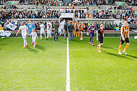 SWANSEA, WALES - APRIL 04: players walk on to the pitch prior to the Premier League match between Swansea City and Hull City at Liberty Stadium on April 04, 2015 in Swansea, Wales.  (photo by Athena Pictures)