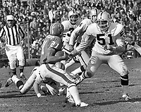 Denver Bronco #21 Randy Montgomery about to meed Oakland Raider Joe Carroll..(1972 photo/Ron Riesterer)