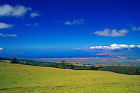 A scenic view from about a 4,500-ft. elevation in upcountry Maui with view of South Shore, West Maui Mountains, Central Valley and the community of Kula.