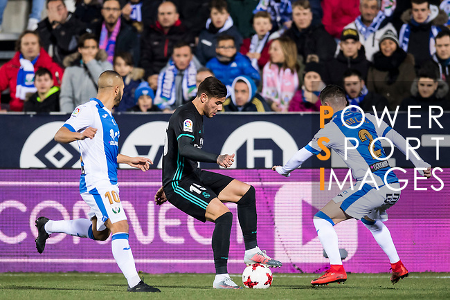 Theo Hernandez (C) of Real Madrid is tackled by Roberto Roman Triguero of CD Leganes during the Copa del Rey 2017-18 match between CD Leganes and Real Madrid at Estadio Municipal Butarque on 18 January 2018 in Leganes, Spain. Photo by Diego Gonzalez / Power Sport Images