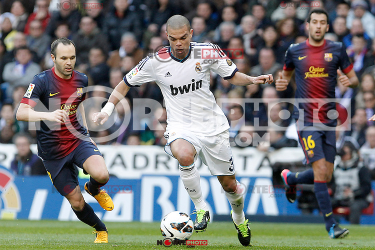 Real Madrid's Pepe (c) and FC Barcelona's Andres Iniesta (l) and Sergio Busquets during La Liga match.March 02,2013. (ALTERPHOTOS/Acero) /NortePhoto