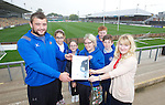 Gwent Dragons hooker Sam Parry presenting Jenna Llewellyn from TATA Steel with a certificate to acknowledge the donation the company have made to the regions community program along with pupils from Deighton Primary School in Tredegar Meagan Pearsall, <br /> Chloe Price, Josh Long, James Davies and teacher Sarah Lewis visiting Rodney Parade.<br /> <br /> 02.10.13<br /> <br /> &copy;Steve Pope-FOTOWALES