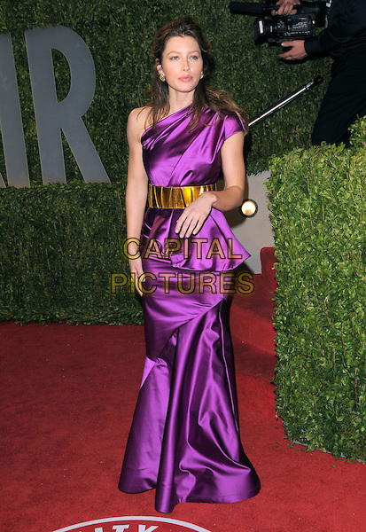 JESSICA BIEL.The 2009 Vanity Fair Oscar Party held at The Sunset Tower Hotel in West Hollywood, California, USA..February 22nd, 2009.oscars full length purple silk satin one shoulder dress gold belt top skirt hand.CAP/DVS.©Debbie VanStory/Capital Pictures.