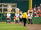 """Washington, D.C. - May 19, 2007 -- The """"Presidents Race"""" is one of the highlights of Major League baseball games at RFK Stadium in Washington, D.C. This race, with the """"Presidents"""" racing on Segways, was run on Sunday, May 19, 2007 during a game against the Baltimore Orioles.  From left to right are Presidents """"Jefferson"""", """"Washington"""", """"Lincoln"""", an unidentified security guard, and """"Teddy Roosevelt"""".  The race is usually run between the visitors and home halves of the fourth inning. .Credit: Ron Sachs / CNP"""