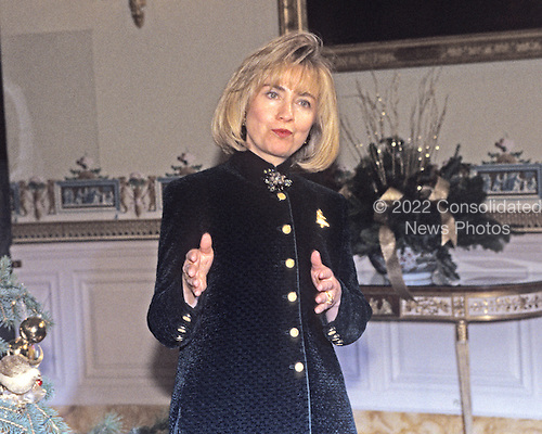 First lady Hillary Rodham Clinton makes remarks in the Blue Room as she hosts a press event to preview the holiday decorations at the White House in Washington, D.C. on December 5, 1994.<br /> Credit: Ron Sachs / CNP