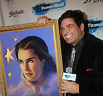 Host Dale Badway (Loving & The City) posed at Fame-Wall New York with the unveiling of her portrait by famed painter Jim Warren and a celebration of Broadway's The Addams Family at a Halloween Party on October 28, 2011 at Hurley's NY, New York City, New York.  (Photo by Sue Coflin/Max Photos)