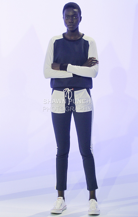 Model poses in an outfit from the PRMITV World Spring Summer 2016 collection by Jacqueline Levine, during New York Fashion Week Spring 2016.