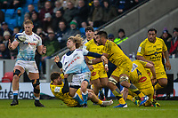 24th November 2019; AJ Bell Stadium, Salford, Lancashire, England; European Champions Cup Rugby, Sale Sharks versus La Rochelle; Faf de Klerk of Sale Sharks is tackled as he passes the ball to Jean-Luc du Preez of Sale Sharks - Editorial Use