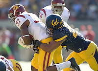 Chad Whitener of California tackles Javorius Allen of USC during NCAA football game at Memorial Stadium in Berkeley, California on November 9th, 2013.   USC defeated California, 62-28.