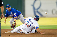 Las Vegas 51s shortstop Jonathan Diaz #6 waits for a throw as baserunner Brad Nelson #30 slides into second base during the Pacific Coast League baseball game against the Round Rock Express on August 7th, 2012 at the Dell Diamond in Round Rock, Texas. The Express defeated the 51s 5-4. (Andrew Woolley/Four Seam Images)..