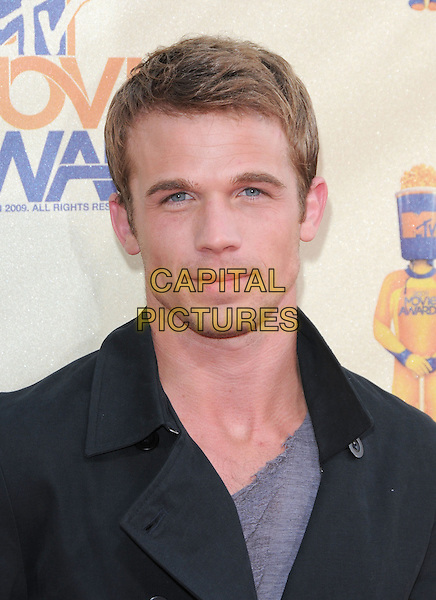 CAM GIGANDET.The 2009 MTV Movie Awards held at Universal Ampitheatre  in Universal City, California, USA..May 31st, 2009 .headshot portrait black blue .CAP/DVS.©Debbie VanStory/Capital Pictures.