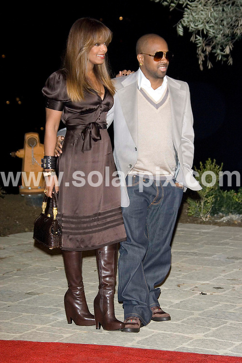 **ALL ROUND PICTURES FROM SOLARPIX.COM**.Janet Jackson and Jermaine Dupri arrives for the Songs of Hope IV at Esquire House 360 Degrees in Beverly Hills on 01.11.06. JOB REF: 3080/PHZ..**MUST CREDIT SOLARPIX.COM OR DOUBLE FEE WILL BE CHARGED**