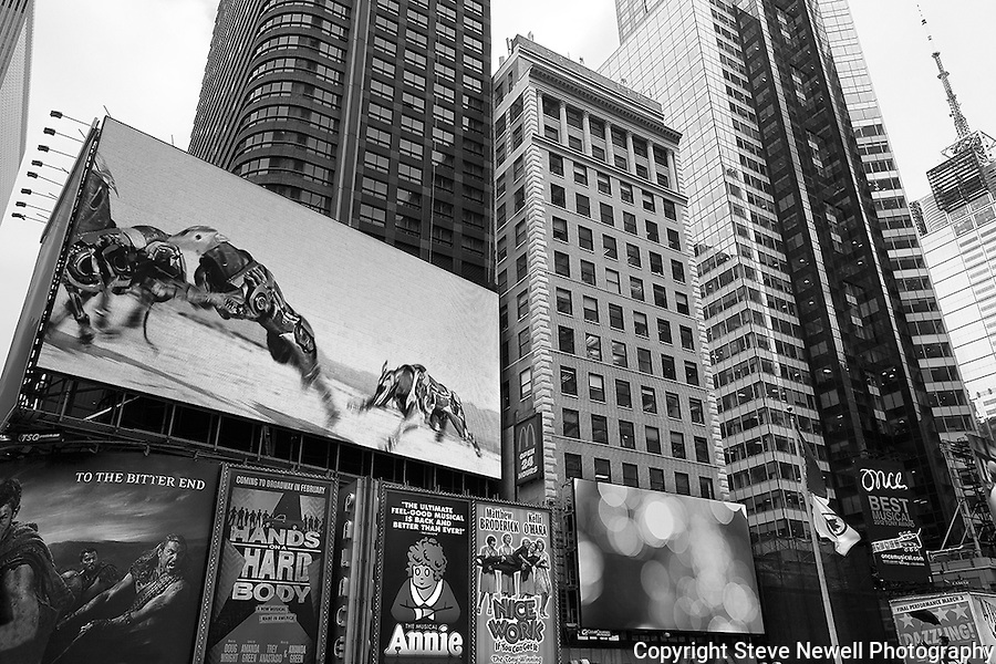 """Annie"" Black and White Times Square Manhattan New York. Times Square is like a little city all to itself that provides plenty of entertainment, bars, restaurants, shopping and attractions for everyone.  You can't possibly do and see it all in a one week vacation. I went to two Broadway plays and one off broadway play while I was staying in Manhattan for eight days shooting photography.  The local employees recommended their favorite restaurants and bars in the area that were excellent and affordable.  Times Square has so much to offer everyone from all walks of life will be satisfied on a visit to the must see district. I made several trips to the area spanning morning noon and night- to late night. When the huge storm blew into New York on the weekend I found myself in the middle of Times Square alone enjoying the light snow fall.  A memory I will cherish!"