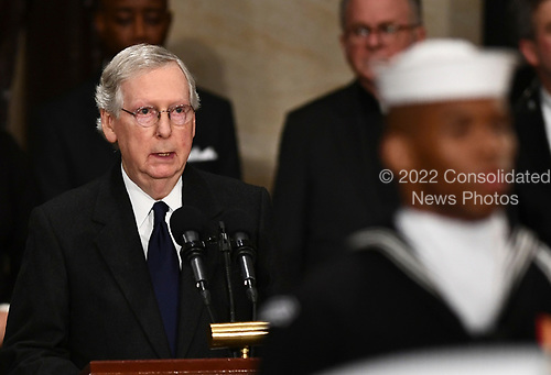US Senator Mitch McConnell (R-KY) speaks as the late former President George H.W. Bush lies in state inside the Rotunda of the US Capitol, December 3, 2018 in Washington, DC. - The body of the late former President George H.W. Bush travelled from Houston to Washington, where he will lie in state at the US Capitol through Wednesday morning. Bush, who died on November 30, will return to Houston for his funeral on Thursday. (Photo by Brendan Smialowski / POOL / AFP)