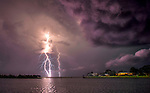 A lightning strikes occurs over the mouth of Walker Creek that leads to the Gulf of Mexico near the community of Shell Point in the north Florida panhandle south of Tallahassee.