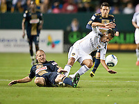 CARSON, CA – April 2, 2011: Philadelphia Union defender Jordan Harvey (2) trips up LA Galaxy midfielder Juninho (19) during the match between LA Galaxy and Philadelphia Union at the Home Depot Center, March 26, 2011 in Carson, California. Final score LA Galaxy 1, Philadelphia Union 0.