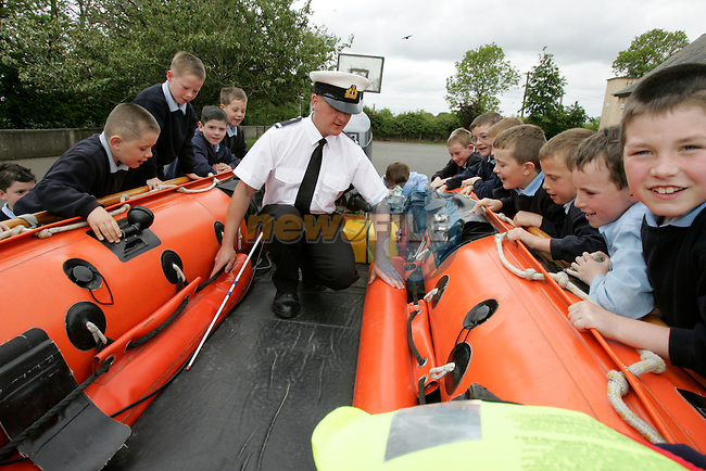 Irish Coast Guard Member Sean Duff with Students from Duleek Boys national School..Photo: Newsfile/Fran Caffrey..The summer is here and the Drogheda Coast Guard Unit are back visiting the local Primary Schools for their Annual Water Safety Talk..This has been a very successful campaign over the last four years; we have educated thousands of children in all aspects of Water Safety form the Louth and Meath Areas..We introduce the children to the basic dangers that they are likely to encounter when visiting the seaside, lakes and rivers. We also teach them the Safe Swimming Guide..We demonstrate the wearing of Lifejackets and Buoyancy Aids, how to get help if the find someone in trouble in the water, at the seaside or near cliffs..We also demonstrate the equipment that the Coast Guard wear and use in different areas of operations..The children are then brought into the schoolyard where we show them one of our Coast Guard Boats and all Life Saving Equipment on board..Last year we visited thirty schools reaching approx. three thousand children..We wish everyone a warm and happy summer..Enjoy our local waterways and coast, always read signs, stay alert and beware of any dangers..If you see any one in difficulty in our local Rivers, Lakes or along our Coast, Call 112 or 999 and ask for the Coast Guard...Dermot Mc Connoran .Area Officer .Drogheda Coast Guard...