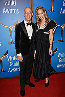 LOS ANGELES, CA. February 17, 2019: Mitch Silpa & Guest at the 2019 Writers Guild Awards at the Beverly Hilton Hotel.<br /> Picture: Paul Smith/Featureflash