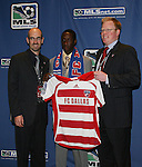 12 January 2007: Abdus Ibrahim was taken with the 1st pick of the second round (14th overall) by FC Dallas. He is flanked by head coach Steve Morrow and General Manager Michael The 2007 MLS SuperDraft was held in the Indianapolis Convention Center in Indianapolis, Indiana during the National Soccer Coaches Association of America's annual convention.