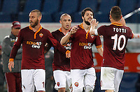 Calcio, Serie A: Roma vs Torino. Roma, stadio Olimpico, 25 marzo 2014.<br /> AS Roma forward Mattia Destro, second from right,  celebrates with teammates, from left, Daniele De Rossi, Radja Nainggolan and Francesco Totti after scoring during the Italian Serie A football match between AS Roma and Torino at Rome's Olympic stadium, 25 March 2014.<br /> UPDATE IMAGES PRESS/Riccardo De Luca