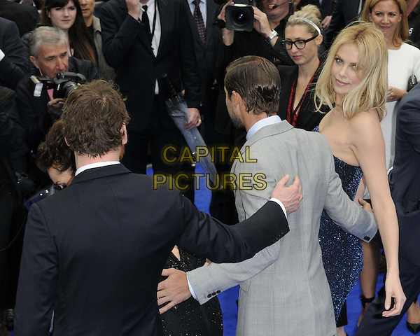 Michael Fassbender, Logan Marshall-Green & Charlize Theron.The 'Prometheus' world film premiere, Empire cinema, Leicester Square, London, England..May 31st, 2012.half length black beads beaded sheer sparkly strapless arms around waist black grey gray back behind rear looking over shoulder .CAP/CAN.©Can Nguyen/Capital Pictures.