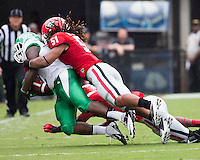 The Georgia Bulldogs played North Texas Mean Green at Sanford Stadium.  After North Texas tied the game at 21 early in the second half, the Georgia Bulldogs went on to score 24 unanswered points to win 45-21.  Georgia Bulldogs linebacker Ramik Wilson (51) tackles North Texas Mean Green running back Reggie Pegram (2)