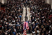 The flag-draped casket of former President George H.W. Bush is carried out by a military honor guard during a State Funeral at the National Cathedral, Wednesday, Dec. 5, 2018, in Washington. <br /> Credit: Andrew Harnik / Pool via CNP