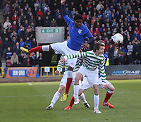 Junior Ogen jumps above Aidan Nesbitt in the Celtic v Rangers City of Glasgow Cup Final match played at Firhill Stadium, Glasgow on 29.4.13,  organised by the Glasgow Football Association and sponsored by City Refrigeration Holdings Ltd.