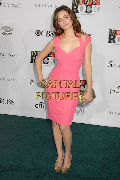 EMMY ROSSUM.2007 Movies Rock Celebration Presented by Conde Nast Media Group at the Kodak Theatre, Hollywood, California USA, 2 December 2007..full length pink dress hand on hip gold clutch bag shoes.CAP/ADM/BP.©Byron Purvis/AdMedia/Capital Pictures.