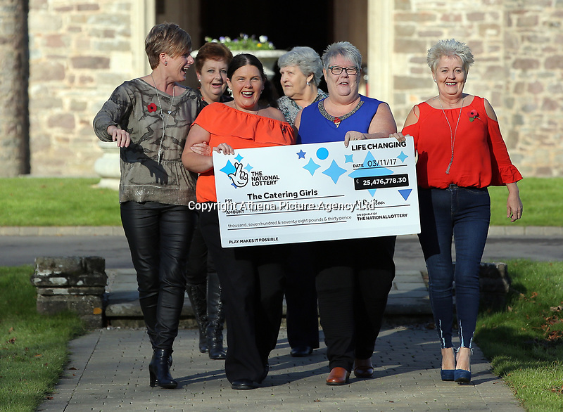 Pictured L-R: Julie Amphlett, Julie Walters, Louise Ward, Jean Cairns, Sian Jones and Doreen Thompson with the check. Wednesday 08 November 2017<br /> Re: Presentation of hospital catering syndicate win £25m in Euromillions Jackpot at Hensol Castle, south Wales, UK. Julie Saunders, 56, Doreen Thompson, 56, Louise Ward, 37, Jean Cairns, 73, SIan Jones, 54 and Julie Amphlett, 50 all work as catering staff for Neath Port Talbot Hospital in south Wales.