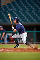 Mississippi Braves right fielder Keith Curcio (14) follows through on a swing during a game against the Montgomery Biscuits on April 24, 2017 at Montgomery Riverwalk Stadium in Montgomery, Alabama.  Montgomery defeated Mississippi 3-2.  (Mike Janes/Four Seam Images)