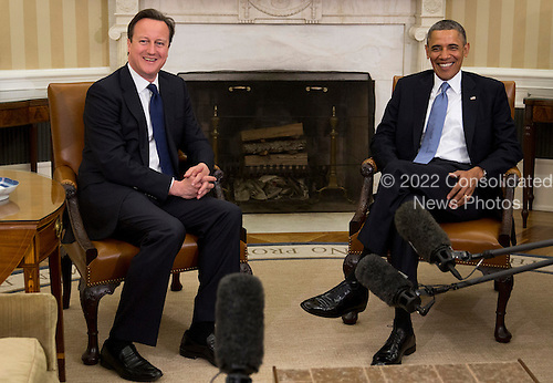 United States President Barack Obama, right, talks to Prime Minister David Cameron of Great Britain in the Oval Office of the White House in Washington, D.C., U.S., on Monday, May 13, 2013. Cameron rebuked lawmakers in his Conservative Party who have already decided that Britain should withdraw from the European Union. .Credit: Andrew Harrer / Pool via CNP