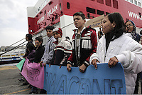 Pictured: Protesters march next to a ship Tuesday 08 March 2016<br />