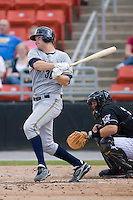 Catcher Brian Baisley (36) of the Charleston RiverDogs follows through on his swing versus the Hickory Crawdads at L.P. Frans Stadium in Hickory, NC, Sunday, May 4, 2008.