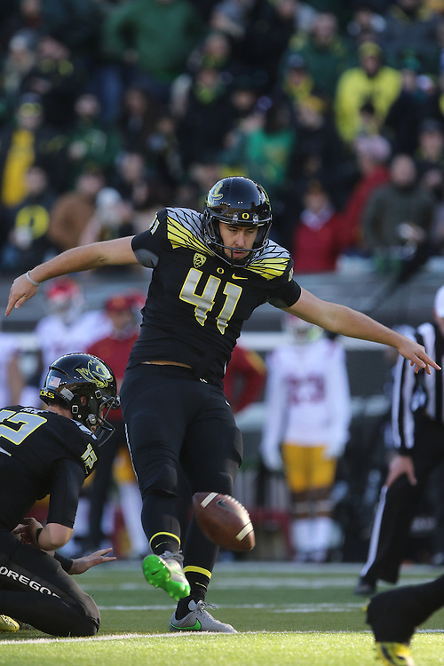 Nov 21, 2015; Eugene, OR, USA; Oregon Ducks place kicker Aidan Schneider (41) makes the extra point after a touchdown against the USC Trojans at Autzen Stadium. <br /> Photo by Jaime Valdez