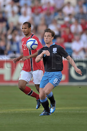 26.05.2012 Oslo, Norway, Scott Parket (Spurs) competes and wins the ball against Daniel Braaten of Norway during the international friendly match  between England and Norway at the Ullevaal Stadion in Oslo, Norway .... England won the game by a score of 0-1.