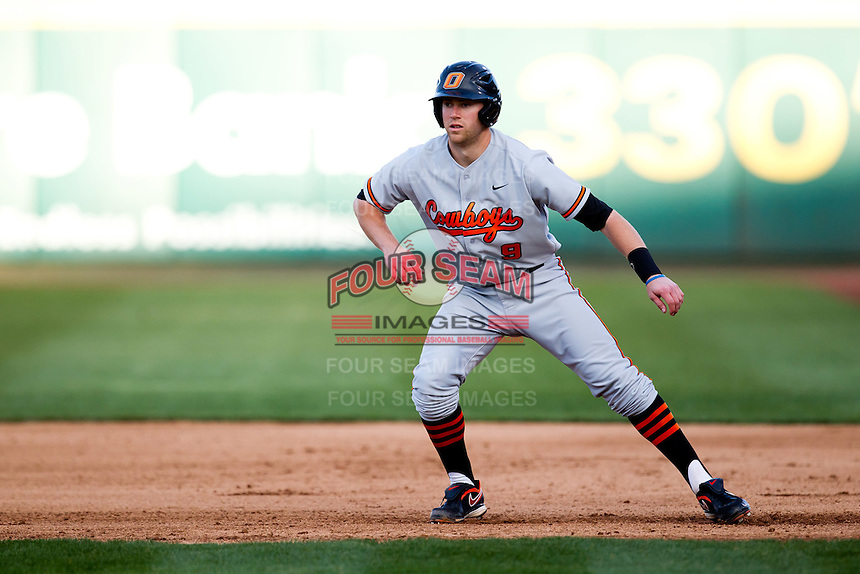 Mark Ginther (9) of the Oklahoma State Cowboys leads off of first base during a game against the Missouri State Bears at Hammons Field on March 6, 2012 in Springfield, Missouri. (David Welker / Four Seam Images)