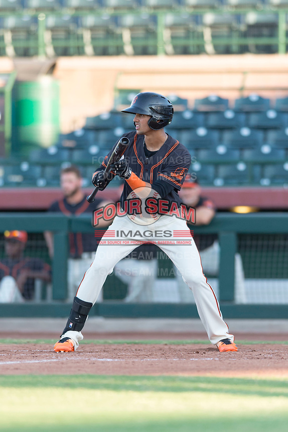 AZL Giants Orange third baseman Abdiel Layer (17) shows bunt during an Arizona League game against the AZL Rangers at Scottsdale Stadium on August 4, 2018 in Scottsdale, Arizona. The AZL Giants Black defeated the AZL Rangers by a score of 3-2 in the first game of a doubleheader. (Zachary Lucy/Four Seam Images)