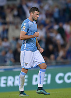 Calcio, Serie A: Lazio vs Frosinone. Roma, stadio Olimpico, 4 ottobre 2015.<br /> Lazio's Filip Djordjevic celebrates after scoring during the Italian Serie A football match between Lazio and Frosinone at Rome's Olympic stadium, 4 October 2015.<br /> UPDATE IMAGES PRESS/Isabella Bonotto