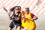 Los Angeles, CA 02/09/13 - Amanda Macaluso  (Northwestern #17) and Courtney Tarleton (USC #1) in action during the Northwestern vs USC NCAA Women Lacrosse game at the Los Angeles Colliseum.