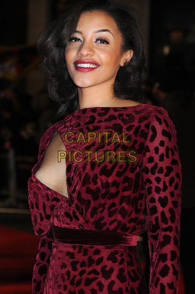 Amal Fashanu.attended the 'Arbitrage' UK film premiere, Odeon West End cinema, Leicester Square, London, England, UK, February 20th 2013..half length pink red cut out leopard print dress long sleeve side boob breast no bra braless flashing side slit split Smiling .CAP/PP/BK.©Bob Kent/PP/Capital Pictures