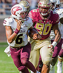 Florida State defensive tackle Demarcus Christmas pursues Louisiana Monroe quarterback Caleb Tucker in the 2nd half of an NCAA college football game in Tallahassee, Fla., Saturday, Dec. 2, 2017. Florida State defeated Louisiana Monroe  (AP Photo/Mark Wallheiser)