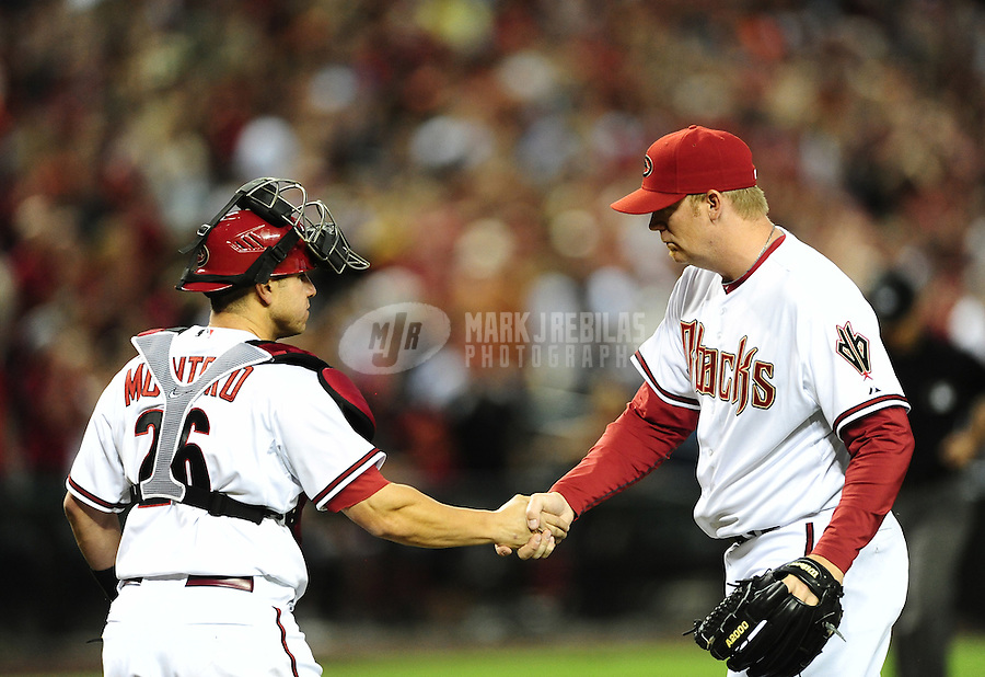 Apr. 6, 2012; Phoenix, AZ, USA; Arizona Diamondbacks pitcher J.J. Putz (right) celebrates with catcher Miguel Montero following the game against the San Francisco Giants during opening day at Chase Field.  The Diamondbacks defeated the Giants 5-4. Mandatory Credit: Mark J. Rebilas-